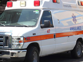 A Parked Ambulance at the Roseau Fire Station